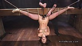 Tied up to wooden beam upside down black brown drilled