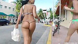 Candid - foxy latin babe in thong bikini walking do...