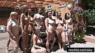 Naked girls posing at a nudist club