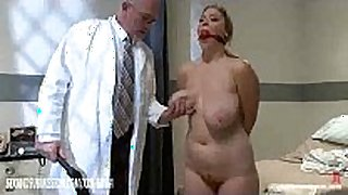 Cosmetic surgery doctor checks the patient's co...