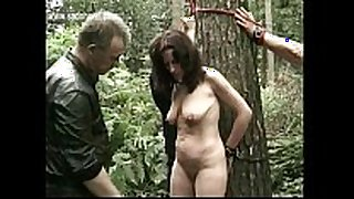 Naked serf bound to a tree got her pierced puss...
